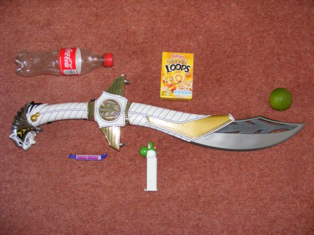A Coke bottle, a Variety Pack, some Parma Violets, a Pez dispenser and a lime.